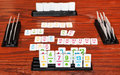Set of tiles in rummy game rack during playing on wooden board Royalty Free Stock Photo