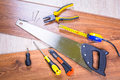 Set of tools for home renovation over a wooden panel Stock Image