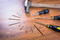 Set of tools for home renovation over a wooden panel Royalty Free Stock Photography