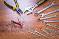 Set of tools over a wooden panel Royalty Free Stock Photo