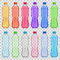 Set of transparent plastic bottles with multicolored juices and Royalty Free Stock Photo