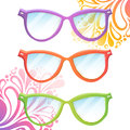 Set of trendy hipster glasses transparent various colors on summer floral background Stock Images