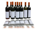 Set of unlabeled wine bottles over white background Stock Photos