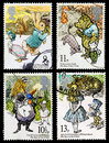 Set used british postage stamps showing childrens books tale peter rabbit winnie pooh wind willows alice wonderland circa Royalty Free Stock Photography