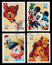 Set of used postage stamps printed in the united states showing bambi mickey mouse pinocchio and the lion king circa Royalty Free Stock Images