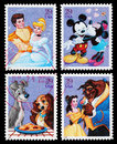 Set of used postage stamps printed in the united states showing the disney characters mickey and minnie mouse cinderella and Stock Photography