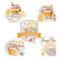 Set of vector colored honey labels, logos, badges and design ele