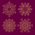 Set from Vector Gold Floral Mandala over purple Royalty Free Stock Photo