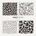 Set of vector seamless patterns of stylized leaves and petals