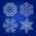 Set of vector snowflakes on blue background Royalty Free Stock Images
