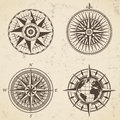 Set of vintage antique wind rose nautical compass signs labels Royalty Free Stock Photo