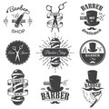 Set of vintage barber shop emblems