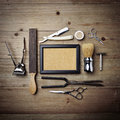 Set of vintage barber shop tools with picture frame