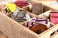 Set of vintage belts in wooden crate casual leather organizer box on background Stock Image