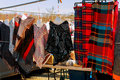 set of vintage clothes of many colors for sale at flea market. Royalty Free Stock Photo
