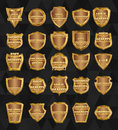 Set of  vintage design elements-golden shields. Royalty Free Stock Photo