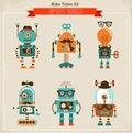 Set of vintage hipster robot icons cute robots Stock Photography
