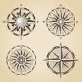 Set of vintage old antique nautical compass roses. Vector signs Royalty Free Stock Photo