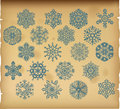 The set of vintage snowflakes on vintage background blue Royalty Free Stock Photography