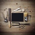 Set of vintage tools of barber shop with black poster