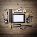 Set of vintage tools of barber shop with empty picture frame