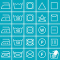 Set of washing symbols laundry icons on blue background Royalty Free Stock Photos
