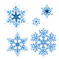 Set of watercolor snowflakes on white background. Hand-painted pattern Royalty Free Stock Photo