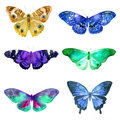 Set of watercolor transparent butterflies in blue, ocher and lilac flowers on a white background