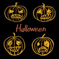 Set of wax crayon hand drawn funny spooky halloween pumpkin with letters on black background. Royalty Free Stock Photo