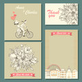 Set of wedding invitation cards and labels with a hand-drawn floral pattern and illustration of a couple on a bicycle. Royalty Free Stock Photo