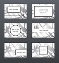 Set of white, black and silver business cards templates. Modern abstract design. Hand drawn ink pattern. Brush texture. Royalty Free Stock Photo