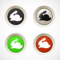 Set of white red green plastic buttons with rabbit silhouette Royalty Free Stock Images