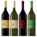 Set of white and red wine bottles isolated on background Stock Photography