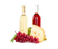 Set of white and rose wine bottles glas and cheese red and white grapes isolated on background Stock Images