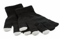 Set of winter gloves with touch pad feature the for modern electronic devices like pads and smart phones Stock Images