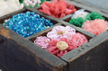 Set of woman s accessories in old wooden box vintage flower hair pins beads and colorful bracelets Stock Images