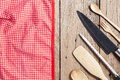 Set of wooden spoon,fork,knife,and red napkin on old wooden tabl Royalty Free Stock Photo
