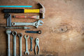 Set of work tools on old grunge wood Royalty Free Stock Photo