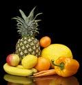 Set of yellow fruits-mandarin,orange,citrus,bananas on black at the bottom Royalty Free Stock Photo