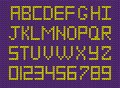 Set of  yellow knitted alphabet and numerals on violet knitted b Royalty Free Stock Photo