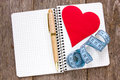 Set your goals measure tape pen and paper heart on the notebook Stock Photography