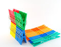 Sets color clothes pegs over white Royalty Free Stock Photo