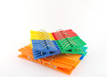 Sets color clothes pegs over white Royalty Free Stock Photos
