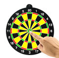 Setting goal or accurate planning finger going to take dart of target Royalty Free Stock Image