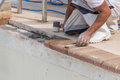 Setting new brick coping pool remodel Royalty Free Stock Photo