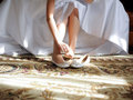 Setting tights bride sitting on bed and her Stock Photography