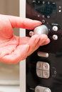 Setting a timer on the microwave oven hand moving knob Royalty Free Stock Photos