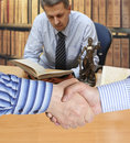 Settlement agreement against the background of lawyer or notary Royalty Free Stock Image
