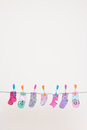 Seven Babies Socks On Washing Line Royalty Free Stock Photo