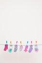 Seven Babies Socks On Washing Line